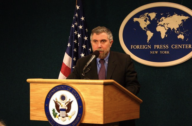 Paul Krugman at the mic, telling another gag
