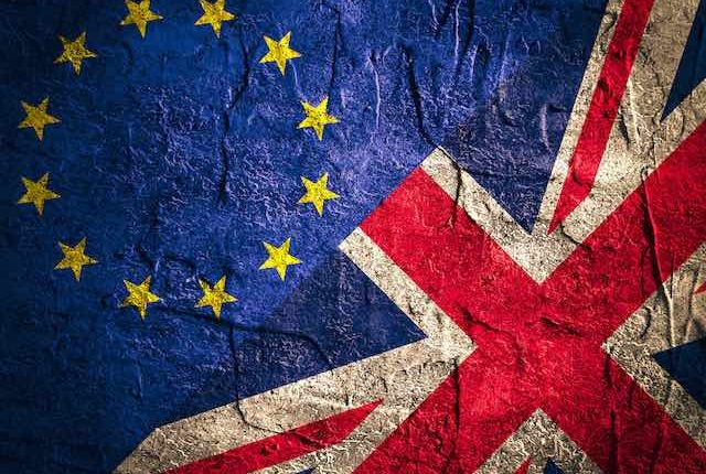 Image relative to politic relationships between Europe Union and United Kingdom. National flags on concrete textured backdrop. Brexit theme